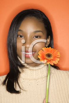 Royalty Free Photo of a Teen Girl Holding a Daisy