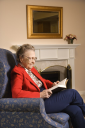 Royalty Free Photo of an Elderly Woman Reading a Book at a Retirement Community Center