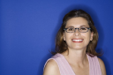 Royalty Free Photo of a Woman Wearing Eyeglasses Smiling