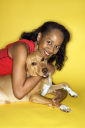 Royalty Free Photo of a Female Hugging a Dog