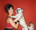 Royalty Free Photo of a Woman Holding a Small White Dog