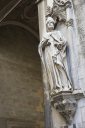 Royalty Free Photo of a Statue on the Side of a Church in Siena