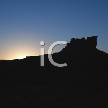 Royalty Free Photo of a Silhouette of Garden of the Gods Rock Formation at Dusk in Monument Valley, Utah