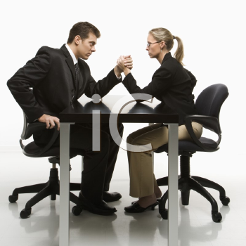 Royalty Free Photo of a Businessman and Businesswoman Arm Wrestling