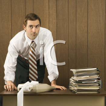 Royalty Free Photo of a Man With Hands on a Desk