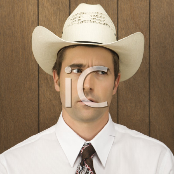 Royalty Free Photo of a Male Wearing a Cowboy Hat Looking Off to the Side