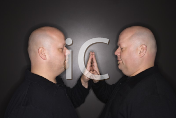Royalty Free Photo of Bald Identical Twin Men Standing With Hands Touching