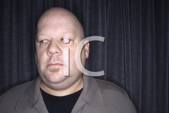 Royalty Free Photo of a Bald Man Looking to the Side