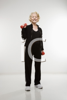 Royalty Free Photo of an Older Woman Lifting Weights