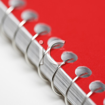 Royalty Free Photo of a Close-Up a Red Spiral Bound Notebook