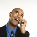 Royalty Free Photo of an African American Man in a Suit Talking on a Cellphone
