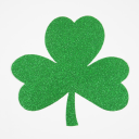 Royalty Free Photo of a Green Glitter Paper Shamrock on White