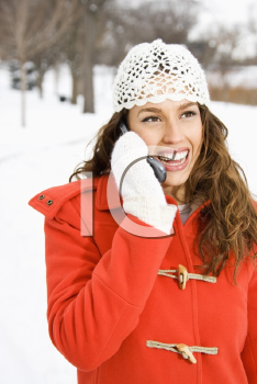 Royalty Free Photo of a Young Woman Holding a Cellphone Outside in the Snow