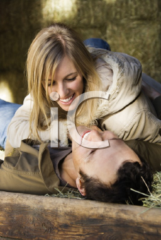 Royalty Free Photo of a Couple Laying in Hay