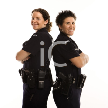 Royalty Free Photo of Policewomen Standing Back to Back With Their Arms Crossed and Smiling