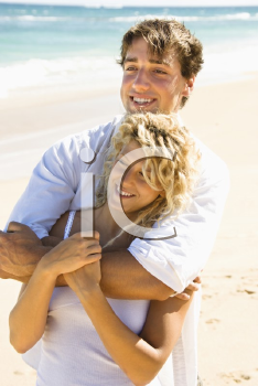 Royalty Free Photo of a Happy Couple Embracing on Maui, Hawaii Beach