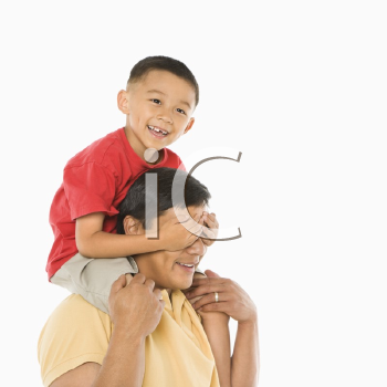 Royalty Free Photo of a Boy Sitting on His Father's Shoulders