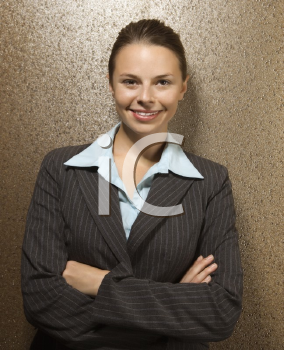 Royalty Free Photo of a Businesswoman Smiling With Her Arms Crossed