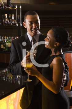 Royalty Free Photo of a Couple Having Drinks at the Bar