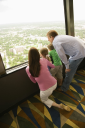 Royalty Free Photo of a Family Looking Out an Observation Deck at Tower of the Americas in San Antonio, Texas