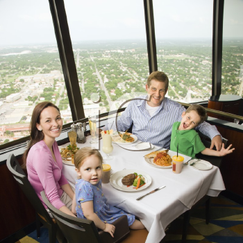 Royalty Free Photo of a Family Having Dinner Together at Tower of Americas Restaurant in San Antonio, Texas