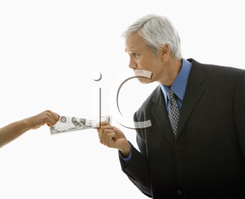 Royalty Free Photo of a Middle-Aged Businessman Pulling a Hundred Dollar Bill From a Woman
