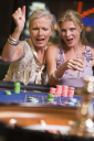 Royalty Free Photo of Two Women at a Roulette Table