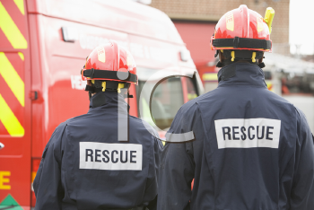 Royalty Free Photo of Two Rescue Workers From the Back