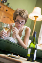 Royalty Free Photo of a Young Woman Drinking Wine and Smoking