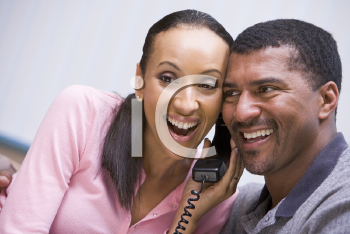 Royalty Free Photo of a Couple Hearing Good News