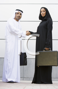 Royalty Free Photo of Two Business People in Arabian Dress