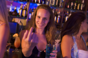 Royalty Free Photo of a Woman in a Bar With Friends