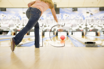 Royalty Free Photo of a Woman Bowling