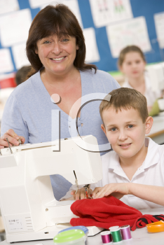 Royalty Free Photo of a Boy Sewing and a Teacher