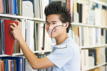 Royalty Free Photo of a Guy in a Library