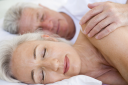 Royalty Free Photo of a Couple Sleeping