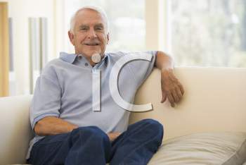 Royalty Free Photo of a Man on a Couch