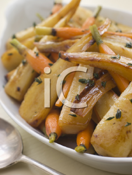 Royalty Free Photo of Parsnips and Baby Carrots Roasted in Thyme and Honey