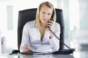 Royalty Free Photo of a Woman With a Datebook Talking on a Phone