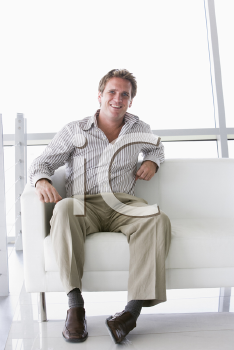 Royalty Free Photo of a Man in an Office Lobby
