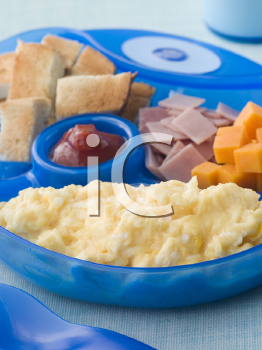 Royalty Free Photo of Scrambled Eggs With Toast Ham and Cheese Squares