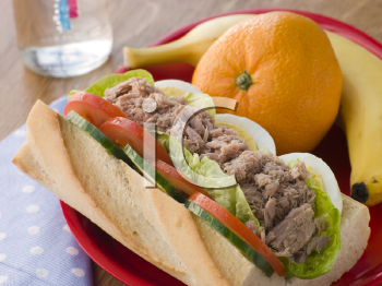 Royalty Free Photo of a Tuna Egg and Salad Baguette With Fresh Fruit