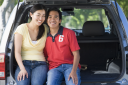 Royalty Free Photo of a Couple in the Back of a Van