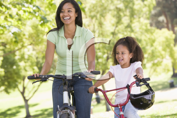 Royalty Free Photo of Two Women on Cycles
