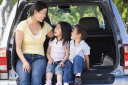 Royalty Free Photo of a Woman in a Hatchback With Two Children