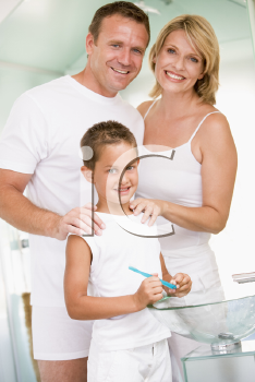Royalty Free Photo of a Couple With Their Son in the Bathroom