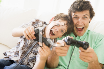 Royalty Free Photo of a Man and His Son Playing Video Games