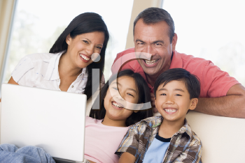 Royalty Free Photo of a Family With a Laptop