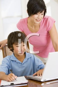 Royalty Free Photo of a Child Getting Help With Homework