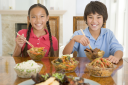 Royalty Free Photo of Two Children Eating Chinese Food